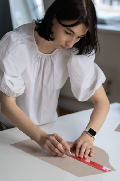 female-tailor-use-ruler-to-sketch-pattern-cloth-to-GQ4BH38-scaled-1-scaled